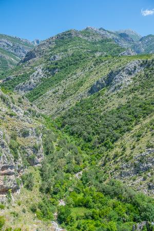 Deep gorge between high mountains. Stock Photo
