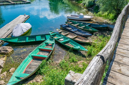 Wooden fishing boats moored to the shore in the village.