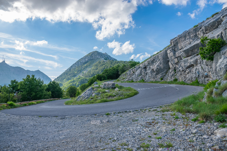 The road leading to the top of the mountain Lovcen. The mausoleum of the Montenegrin ruler Negush is located there. Stock Photo