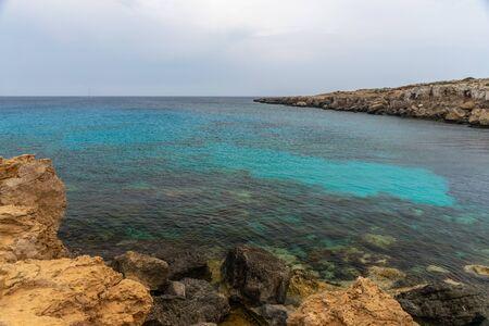 The picturesque of the coast of the calm sea. Фото со стока