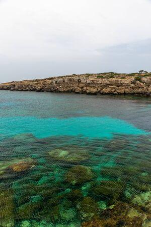 The picturesque of the coast of the calm sea. Banco de Imagens