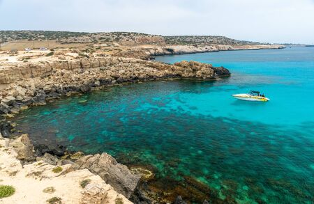 CYPRUS, CAPE CAVO GRECO - MAY 112018: Tourists sailed on a motor boat into the blue lagoon for swimming.