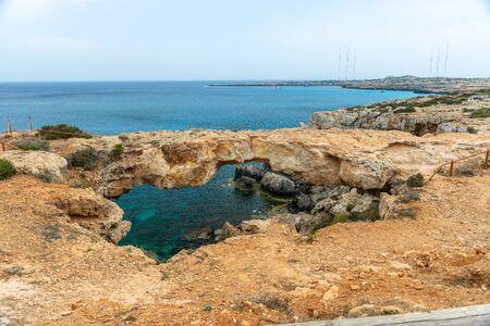 On the Mediterranean coast is a bridge of lovers. Cyprus. Фото со стока