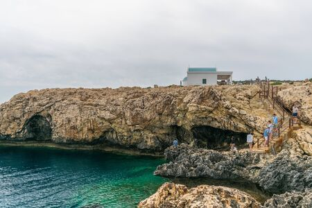 CYPRUS - MAY 11/2018: Tourists go down the stairs to a cave on the coast of the Mediterranean Sea. Editoriali