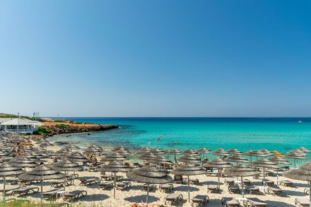 Tourists relax on the famous beach of Cyprus. Nissi Beach Banco de Imagens