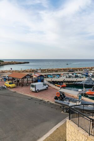 CYPRUS, PROTARAS - MAY 11/2018: Fishermen moored their boats at the pier in the village. Editoriali