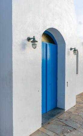 The wooden blue door is an element of Greek culture. Archivio Fotografico
