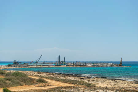 CYPRUS, AYIA NAPA MARINA - MAY 12/2018: builders are working on the construction of a seaport.