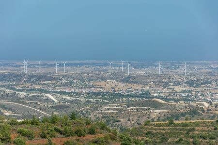 A wind farm is located along a picturesque valley. Archivio Fotografico - 145924829