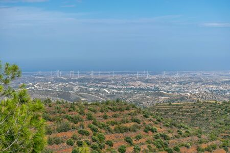 A wind farm is located along a picturesque valley. Archivio Fotografico