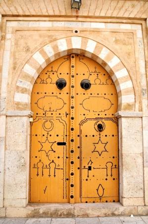 Decorated door in Tunis medina Stock Photo
