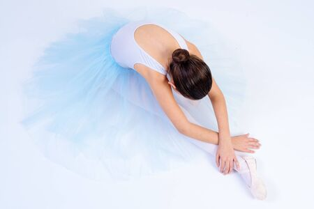 Ballet dancer with white tutu isolated with white background. Ballet classes at the classical dance school 版權商用圖片