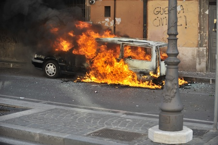Rome, Italy - October 15, 2011: Anti-greed protesters rallied globally on Saturday, denouncing bankers and politicians over the international economic crisis, with violence rocking Rome where cars were torched and bank windows smashed