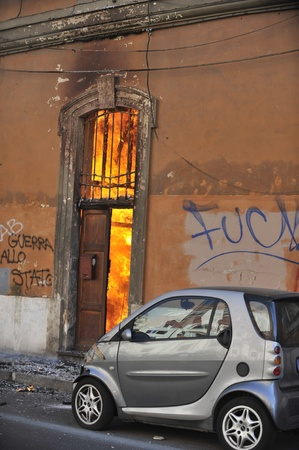 Rome, Italy - October 15, 2011: Anti-greed protesters rallied globally on Saturday, denouncing bankers and politicians over the international economic crisis, with violence rocking Rome where cars were torched and bank windows smashed Editorial
