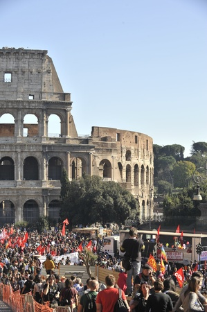 Rome, Italy - October 15, 2011: Hundreds of hooded demonstrators clashed with police in some of the worst violence in the Italian capital for years, setting cars on fire and breaking shop and bank windows.  Editorial