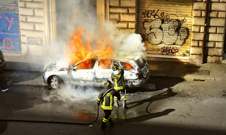 riots: Riots - Fire fighters respond to a car fire
