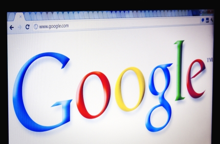 google: Focus on the Google logo viewed through Chrome web browser Editorial
