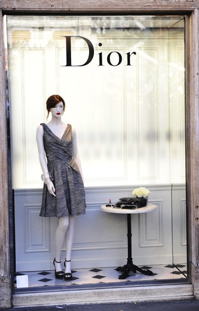 The Dior sign on Christian Dior shop in Rome  Dressed mannequin in high fashion Christian Dior shop window  Stock Photo - 13062297