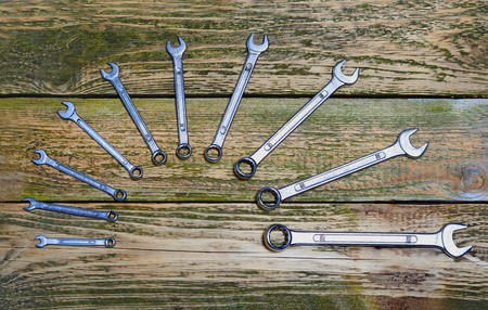 Set of tools on the wood background  photo