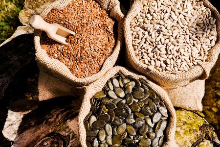 Pumpkin seeds, sunflower and flax seeds in  jute bag.