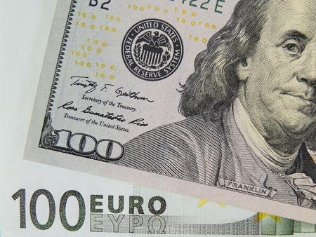 Dollar and euro banknotes close-up.