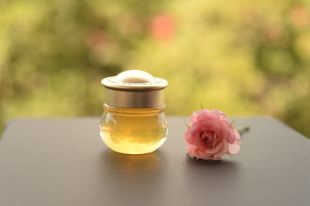 bottle of honey for health ans cos metic with one of pink rose