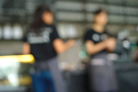 blur two waitress in black T-shirt at coffee bar