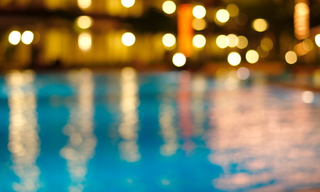 blur night light reflection in blue waving water
