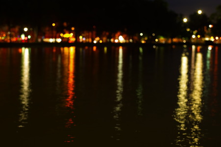 city light: blur reflection of city light in water background Stock Photo