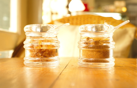 unrefined: organic brown sugar in clear jar on wood table Stock Photo