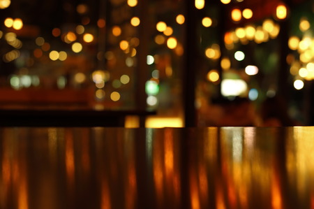 blur reflection light on table in bar and restaurant at city night