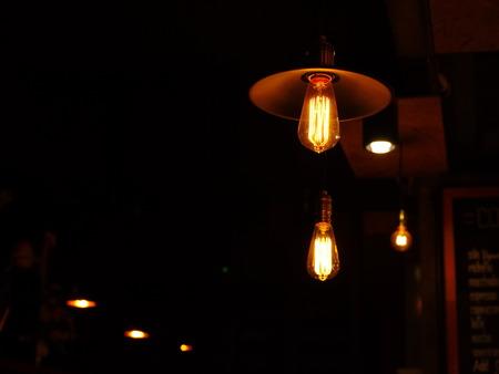 haunting: light bulb lamp in the dark night