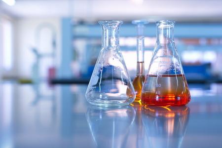 science laboratory glassware orange solution 스톡 콘텐츠