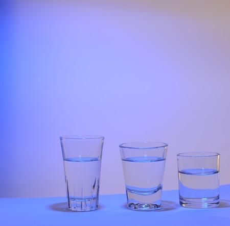 dring: three glasses dring shot in blue light