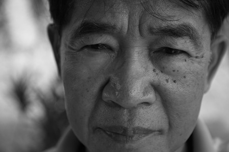 60 years old: 60 years old Asian man portrait in black and white