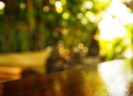 table surface: empty wood table surface with blur green garden natural background Stock Photo