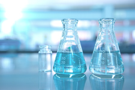 two blue flask in science lab background