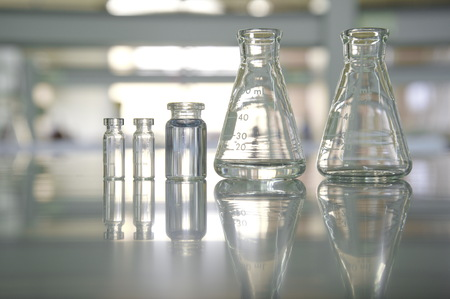 reflection clear flask and vial in science laboratory background Stock Photo