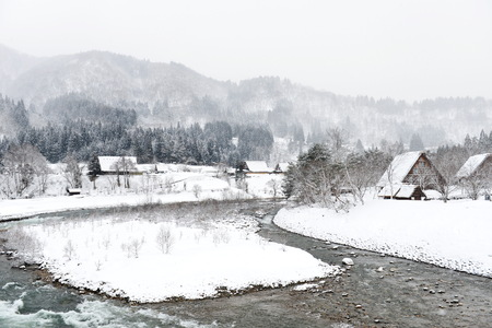 cold snow fall winter in the old Japanese village surround by mountain and forest nature background