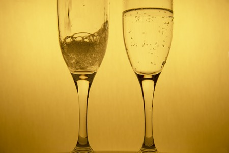 movement of poring bubble alcohol drinking in couple golden champagne glasses for luxury Christmas celebration party background
