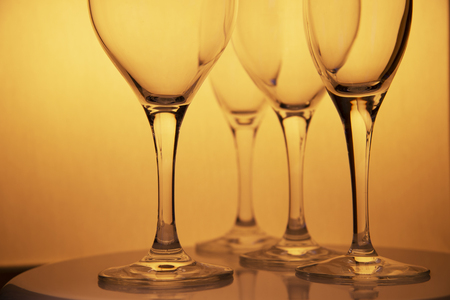 yellow gold drinking wine champagne luxury glasses on food dining table celebrate and party background