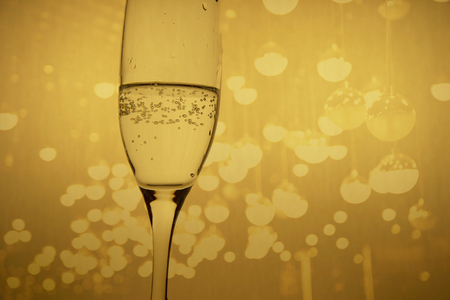 champagne sparking alcohol drinking glass for night party in bar celebrate with golden background