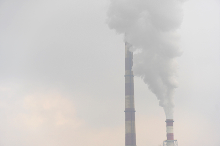 smoke smog air pollution from stack of power generation factory cloudy environmental background