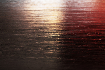 black wood with red light rough textured surface background