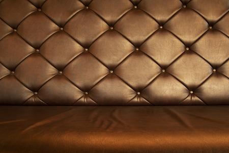 retro dark brown leather sofa or armchair furniture  textured interior background