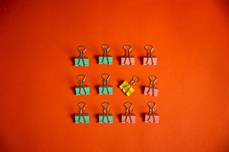 metal pink yellow green pastel paper clip for education and business on orange background 版權商用圖片