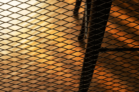 black loft metal net architecture decoration of the room with orange sunlight background