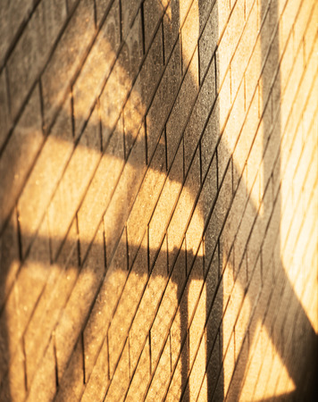 architecture black shadow and orange light on brick wall background