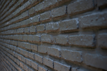 side angle perspective of textured black brick wall interior loft background 版權商用圖片