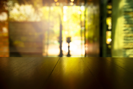 top of black table with green nature window light in bar and restaurant background